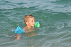 Boy learns swiming. Sumer sport Stock Photography