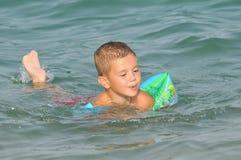 Boy learns swiming. Sumer sport Stock Photo