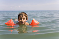 Boy learns swiming. Child,  sand Royalty Free Stock Photography
