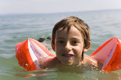Boy learns swiming. Child,  sand Stock Photography