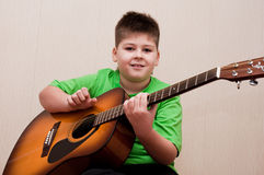 Boy learns to play the guitar Royalty Free Stock Images