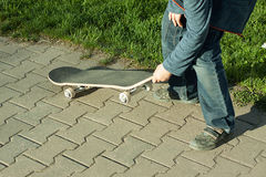 Boy learns to ride a skateboard Stock Images