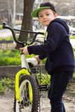 The boy learns to ride a teen bike stock photo