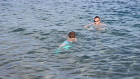 Boy Learns to Swim with Father stock video footage