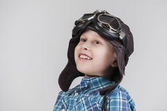 Boy with leather cap looking upwards Royalty Free Stock Photography