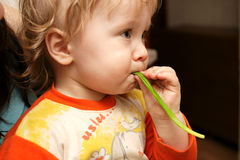 Boy with leek. The boy with leek plays at home Royalty Free Stock Photo