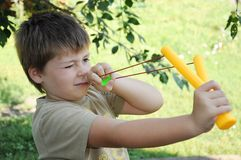 A boy with a left-handed catapult Stock Photo