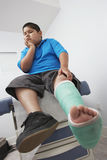 Boy With Leg In Plaster Cast Royalty Free Stock Photography
