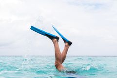 Man legs with flippers diving into water royalty free stock images