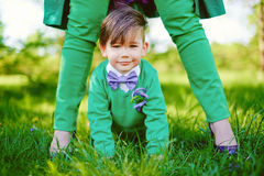 Boy between the legs of his mother Royalty Free Stock Photo