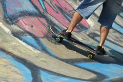 Boy legs on a skateboard Royalty Free Stock Image