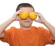 Boy with lemons Stock Photos