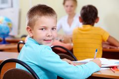 Boy at lesson Royalty Free Stock Image