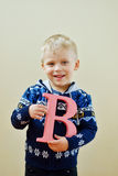 Boy with letter b Stock Photography