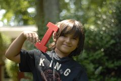 Boy with letter I Royalty Free Stock Photo