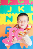 Boy with letters Stock Image