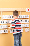 Boy and letters Stock Photos