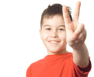Boy letting out a victory yell. Boy with arms in the air letting out a victory yell royalty free stock photo