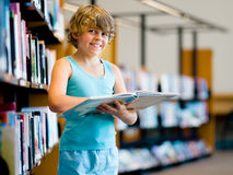 Boy in library Stock Images