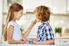 Boy licking on lime fruit Royalty Free Stock Photos