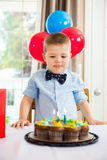 Boy Licking Lips While Looking At Birthday Cake Stock Photo
