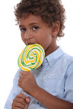 Boy licking a lollipop Royalty Free Stock Photo
