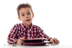 Boy licking mouth befor food Stock Photo
