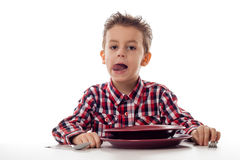 Boy licking mouth befor food Stock Photography