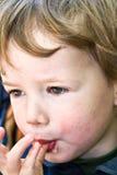 Boy licks fingers Royalty Free Stock Photo