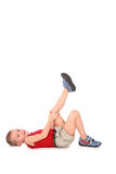 Boy lie with leg up. On white Royalty Free Stock Images