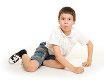 Boy lie on white Stock Photos