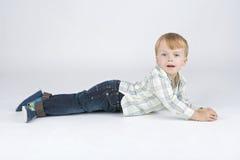 Boy lies. Stock Photo