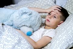 A boy took ill,and treated stock photography