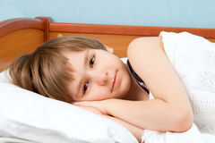The boy lies in bed Stock Photography