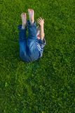 Boy lies on a grass Royalty Free Stock Photo