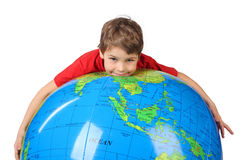 Boy lies on inflatable globe isolated on white Stock Images