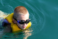 The boy in a life jacket Royalty Free Stock Photography