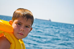 Boy in life jacket Stock Image