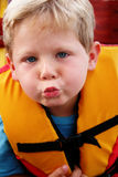 Boy in a life jacket. Happy four year old boy wearing a life jacket Royalty Free Stock Images