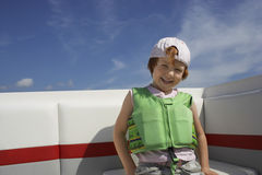 Boy In Life Jacket Sitting On Yacht Stock Photo