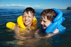Boy in the life-vest. No smiling boy in the life-vest in the water royalty free stock images