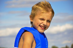 Boy in lifejacket. Boy on a boat looking at the water Stock Image