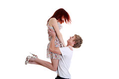 Boy lifting up his girlfriend. Stock Photography