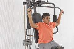 Boy lifting weights Stock Photos