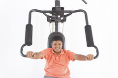 Boy lifting weights Stock Photo