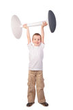 Boy lifts stool Royalty Free Stock Images