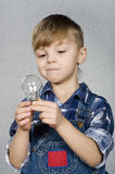Boy and light bulb Royalty Free Stock Photography