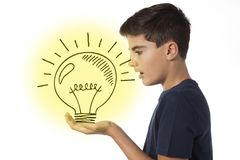 Boy with light bulb - idea concept stock images
