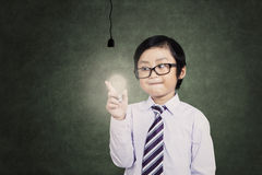 Boy with a light bulb Royalty Free Stock Photography