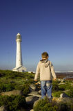 Boy at lighthouse. Little boy making his way towards the Kommetjie lighthouse,Cape Town, South Africa Royalty Free Stock Image